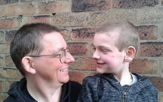 Russell and son after the hair cut